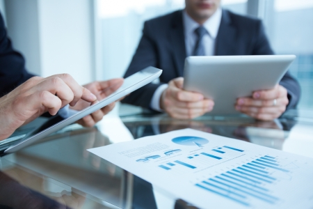 mobile device: Close-up of business partners using touchpads Stock Photo