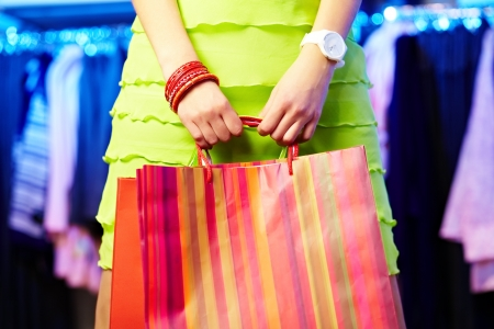 Image of shopaholic hands with shopping bags photo