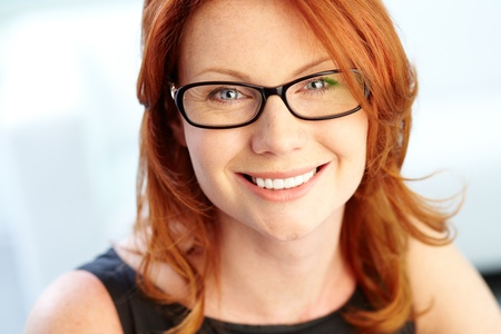 redhaired: Close-up shot of a wonderful red-haired woman looking at camera
