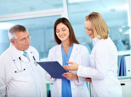 healthcare workers: Portrait of successful medical workers discussing plan in hospital Stock Photo