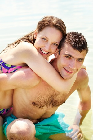 Portrait of happy couple on summer vacation looking at camera photo