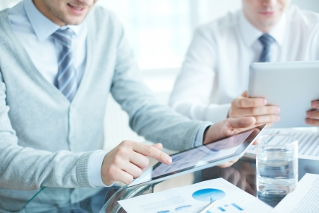 Close-up of businessmen using touchpads