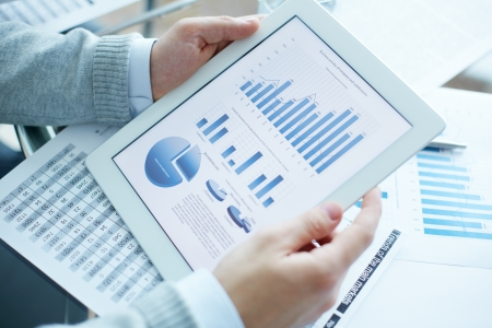 Close-up of businessman holding touchpad with electronic document photo