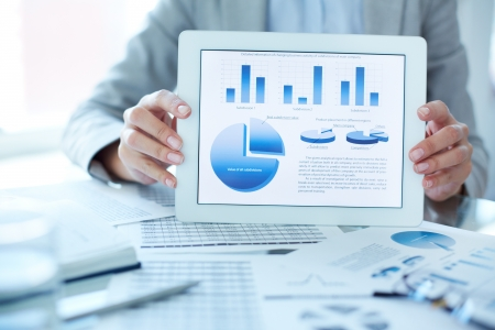 Close-up of businesswoman presenting financial situation in touchpad photo