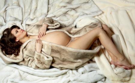 Photo of beautiful pregnant woman in luxurious fur coat Stock Photo - 20733384
