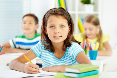 Lovely girl being busy with acquiring knowledge photo