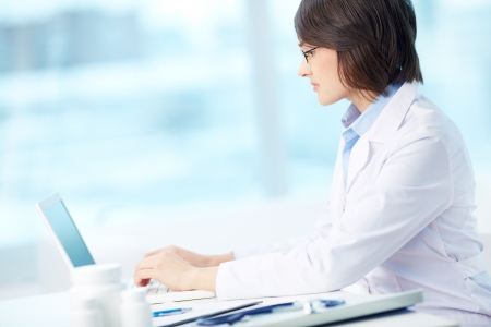 doctor computer: Lovely intern doing her work with the help of a modern device