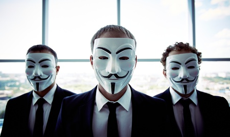 guy fawkes mask: Portrait of three business people wearing anonymous masks Editorial