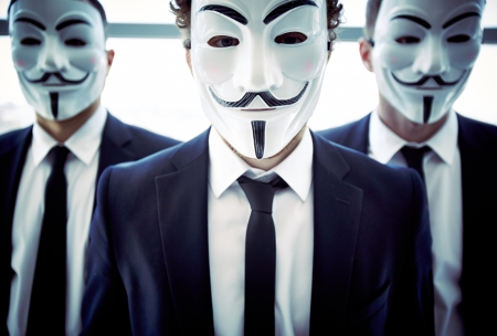 anonymity: Portrait of a business team with their faces being covered with masks Editorial