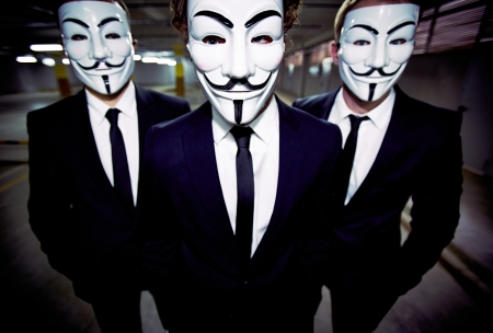 vendetta: Close-up portrait of a group of people of the uniform appearance wearing Guy Fawkes masks Editorial