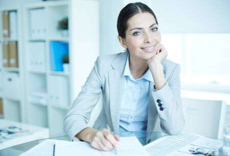 woman in business: Portrait of an elegant manager sitting at her workplace