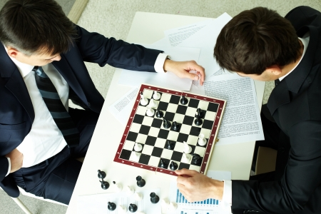 The above view of business partners playing chess, conceptual image photo