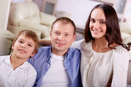 Portrait of happy family of three looking at camera  Stock Photo - 21063329