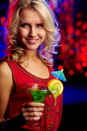 Image of happy girl holding cocktail at party photo