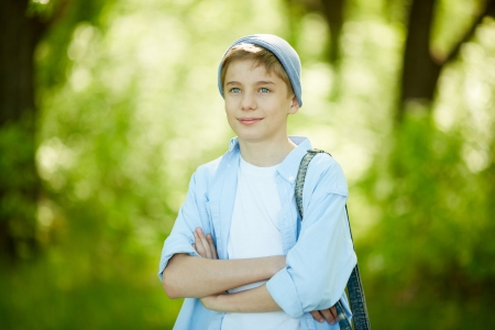 Portrait of cute lad in casual clothes outside    Stok Fotoğraf
