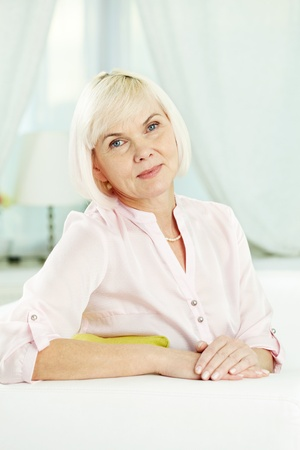 pensionary: Portrait of blond female looking at camera Stock Photo