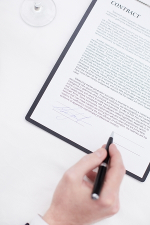diplomacy: Image of businessman hand with pen signing contract