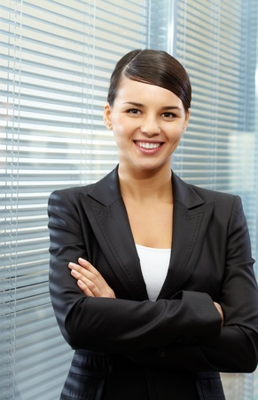 Image of formal businesswoman in suit on the background of jalousie Stock Photo - 21174344