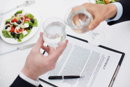 final: Image of businessman hands toasting with glasses with signed contract near by Stock Photo