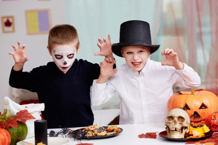 antichrist: Photo of twin eerie boys looking at camera with frightening look  Stock Photo