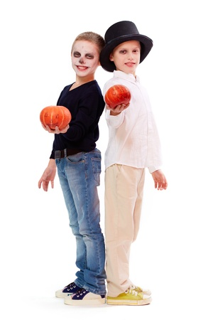 antichrist: Photo of two eerie boys with Halloween pupkins looking at camera  Stock Photo