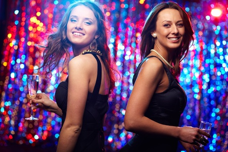 Image of adorable girls in motion enjoying themselves in the club photo