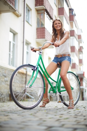 Portrait of a pretty woman on bicycle  photo