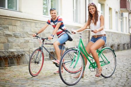 Portrait of happy young couple on bicycles photo