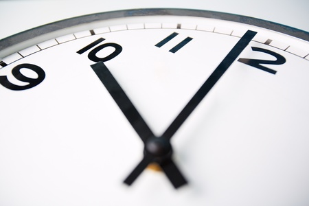last minute: Macro shot of a clock face showing ten o'clock