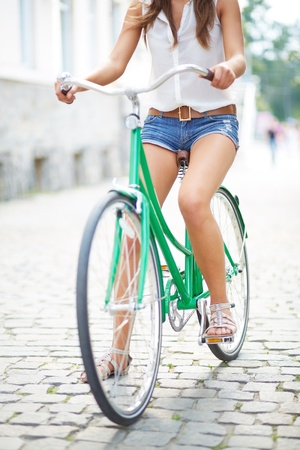 Close-up of young woman on bicycle photo