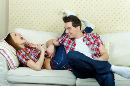 tickling: Playful guy tickling his girlfriend  Stock Photo