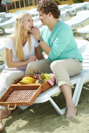 Photo of happy couple having lunch together on resort photo