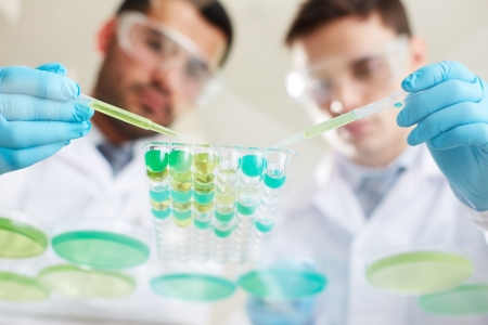 laboratory research: Two clinicians working with liquids in laboratory Stock Photo