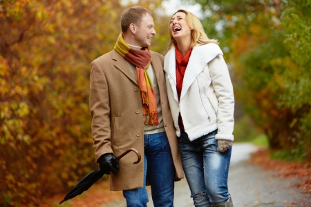ecstatic: Portrait of ecstatic couple during walk in autumnal park
