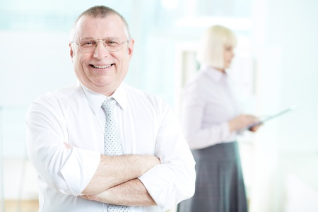 Portrait of smiling boss looking at camera with female standing on background Stock Photo - 21447279