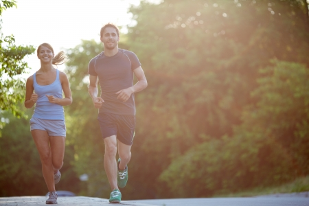 Photo of happy couple running outdoors photo