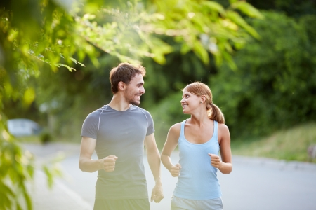 Photo of happy couple running outdoors Reklamní fotografie