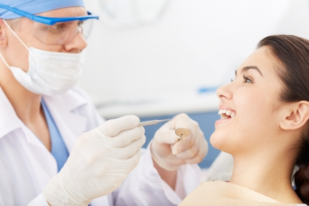 Young girl with open mouth before oral checkup looking at the dentist Reklamní fotografie