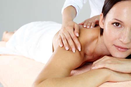 therapeutical: Pretty brunette enjoying the procedure of massage