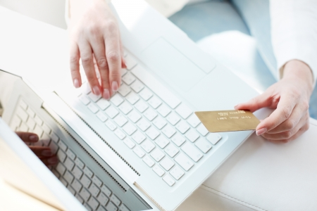 discount card: Female hands with credit card during shopping through Internet