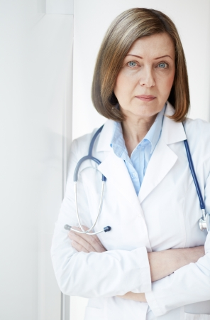 serious doctor: Portrait of successful female practitioner looking at camera