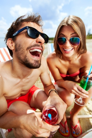beach party: Relaxed young lovers having fun on the beach on a sunny day