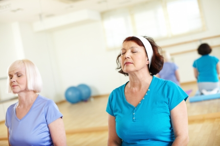 Portrait of two aged females relaxing in sport gym