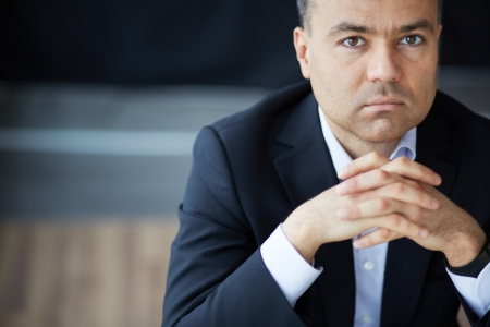 serious face: Portrait of elegant businessman looking at camera