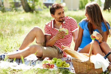 adult sandwich: Happy young dates having picnic in the country Stock Photo