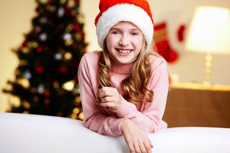 christmas girl: Portrait of a cute girl on a Christmas eve being excited about celebration Stock Photo