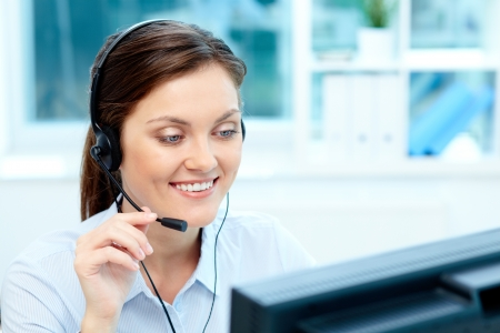 Close-up image of a cheerful representative wearing a headset Stock Photo - 21817700