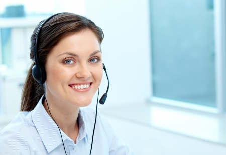 experienced operator: Portrait of a friendly-looking girl providing online service