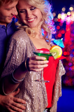 Vertical image of a cheerful beauty hanging out in the club with her boyfriend photo