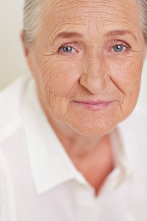 one of a kind: Face of elderly female looking at camera